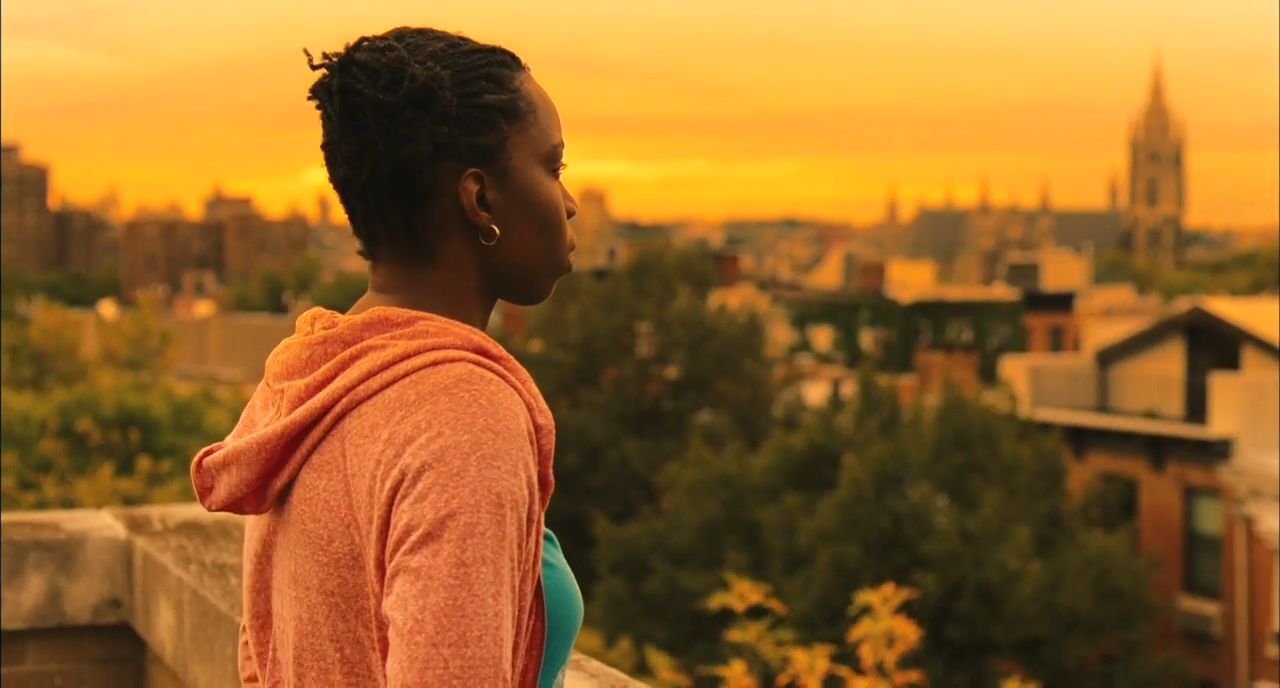 Adepero Oduye in Pariah. She overlooks a city at sunset.