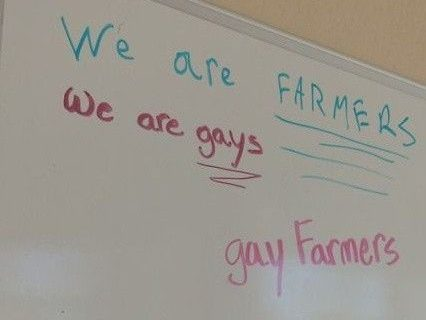 A whiteboard reads: We are FARMERS. We are gays. gay Farmers.