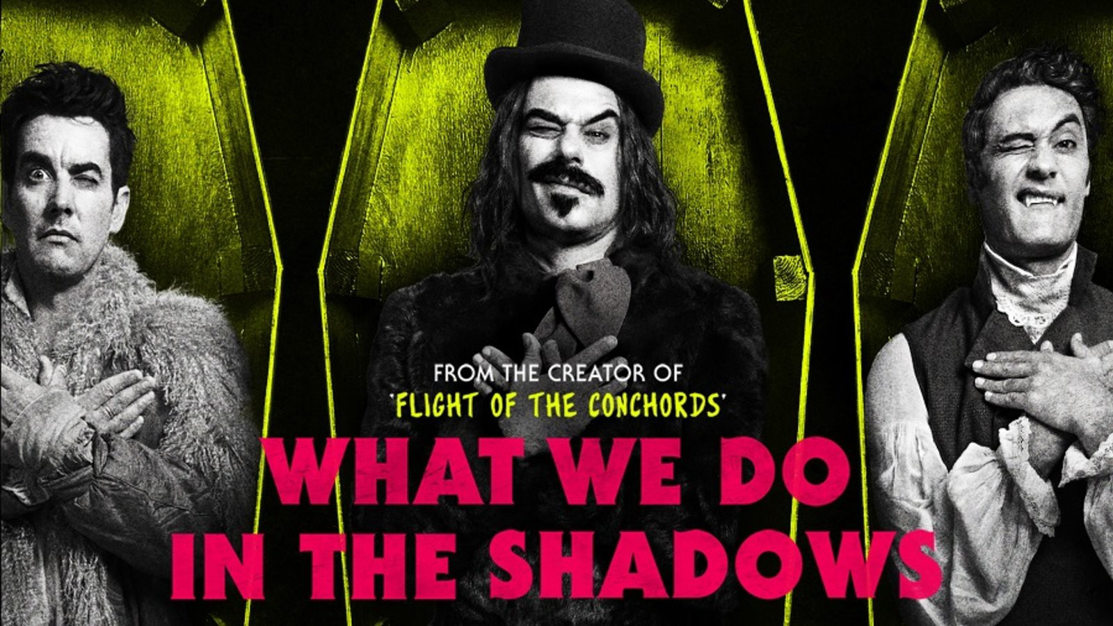 """A promotional poster for """"What We Do In The Shadows."""" Three well-dressed vampires lie in coffins. All have one eye open and their arms crossed over their chests."""