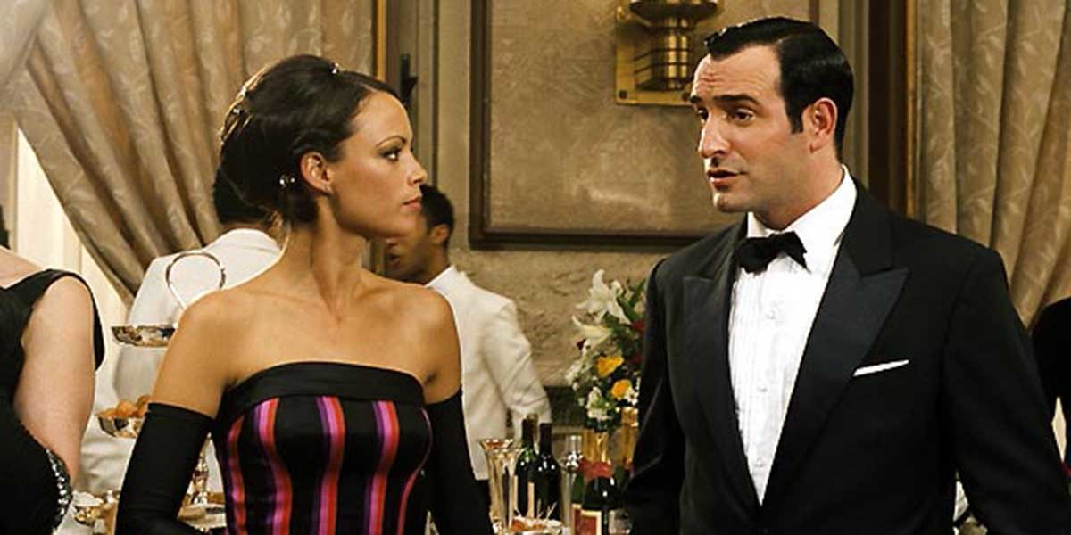 Larmina and OSS 117 attend a party in elegant evening wear