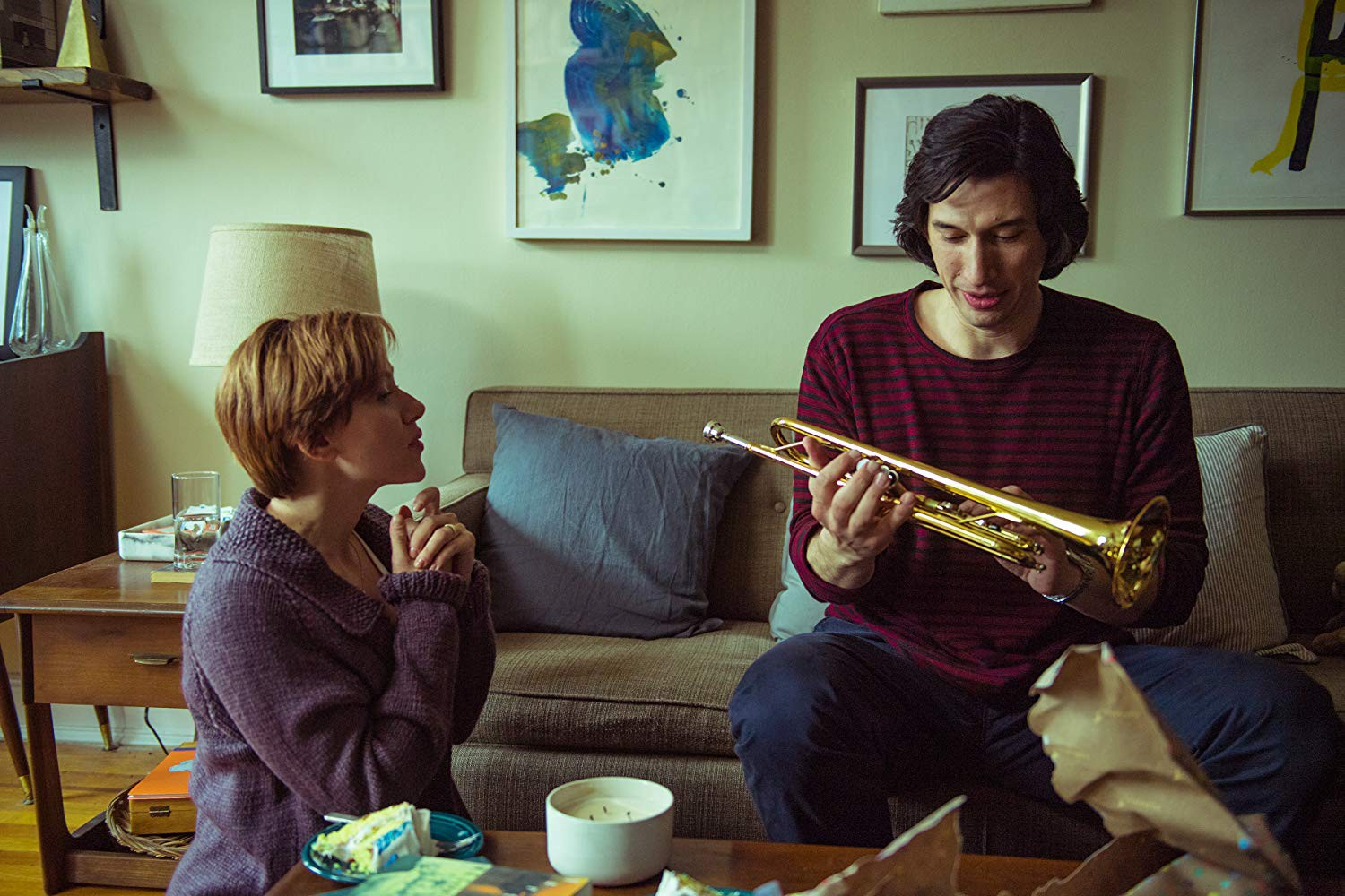 Nicole gives Charlie a trumpet