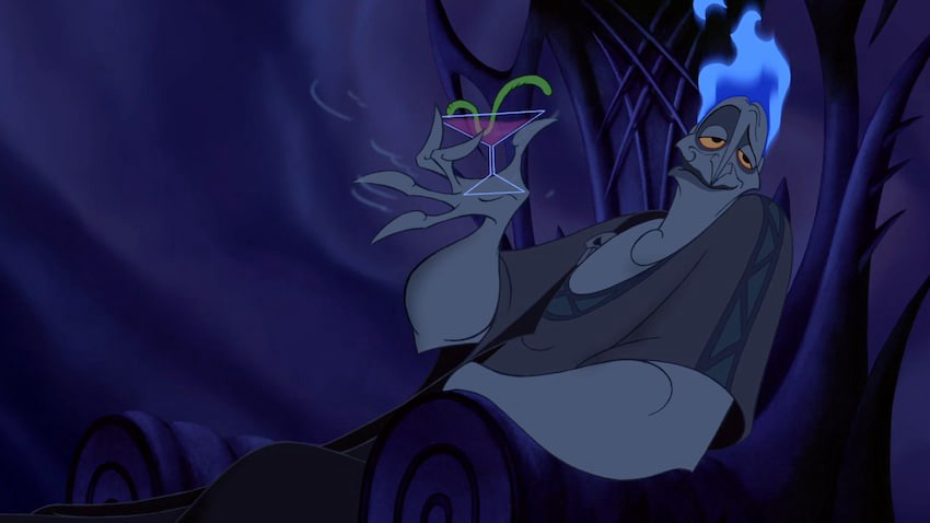 Hades lounges with a drink