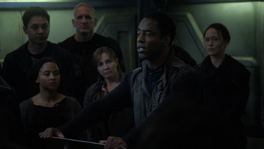 Thelonius (Isaiah Washington) speaks to a group aboard a space station