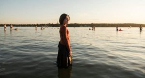 Esty standing in the lake