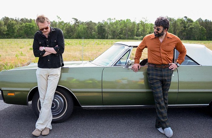 Frank and Wally standing near the car