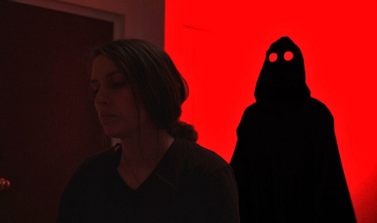 """Short Film """"Sleep No More"""" Cover Image of a dark figure looming behind a young woman"""