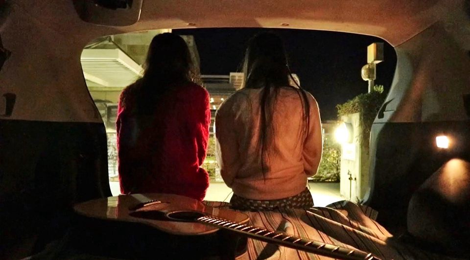 """Short Film """"Small Talk"""" Cover Image of two girls sitting in the trunk of a car"""