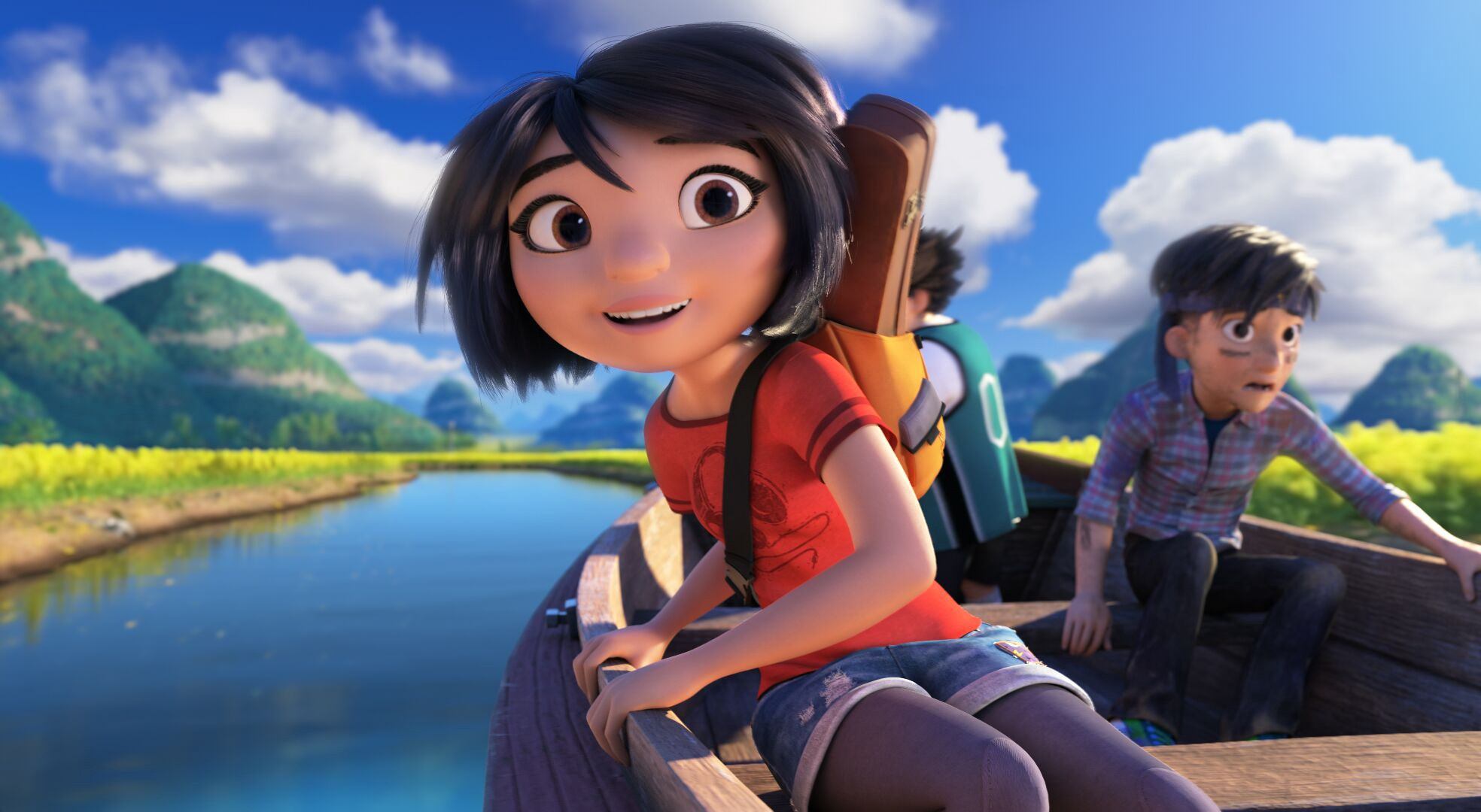Yi, Peng, and Jin sail down a river in Tibet. Behind, them, a blue sky and fluffy clouds over mountains can be seen. Yi has an excited smile on her face and Jin looks frightened.