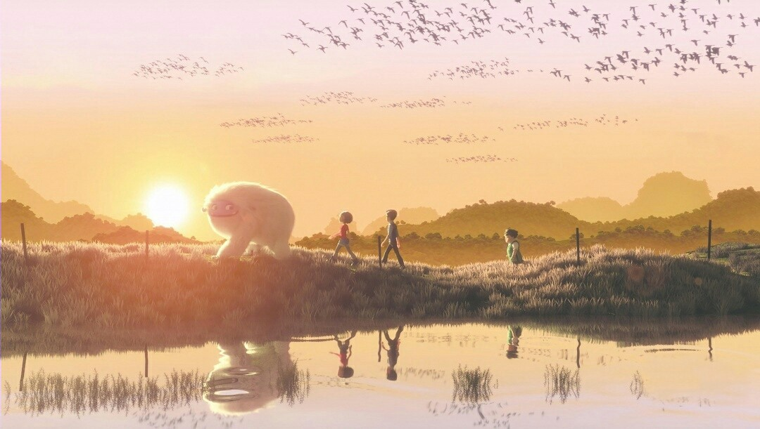 The Yeti, Yi, Jin, and Peng walk through a field at sunset. They are reflected in a nearby river, and birds fly above them.