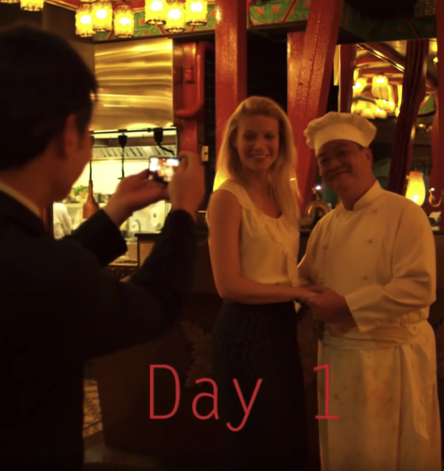 """Contagion's Patient Zero (Gwenyth Paltrow) poses for a photo with a chef. A caption at the bottom reads """"Day 1."""""""