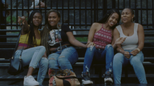 4 girls hanging out on the bleachers