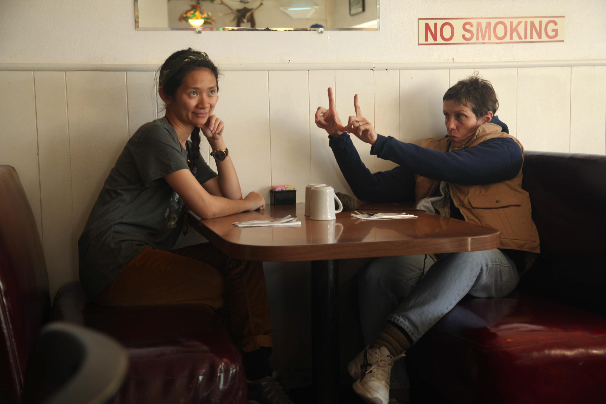 Chloe Zhao (left) and Frances McDormand (right) during filming