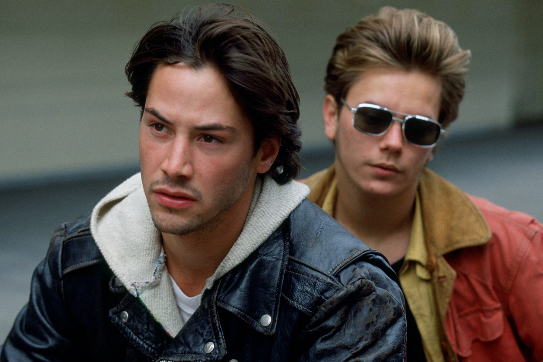 """(Left) Keanu Reeves as """"Scott"""", (Right) River Phoenix as """"Mike"""" in 'My Own Private Idaho' (1991)."""