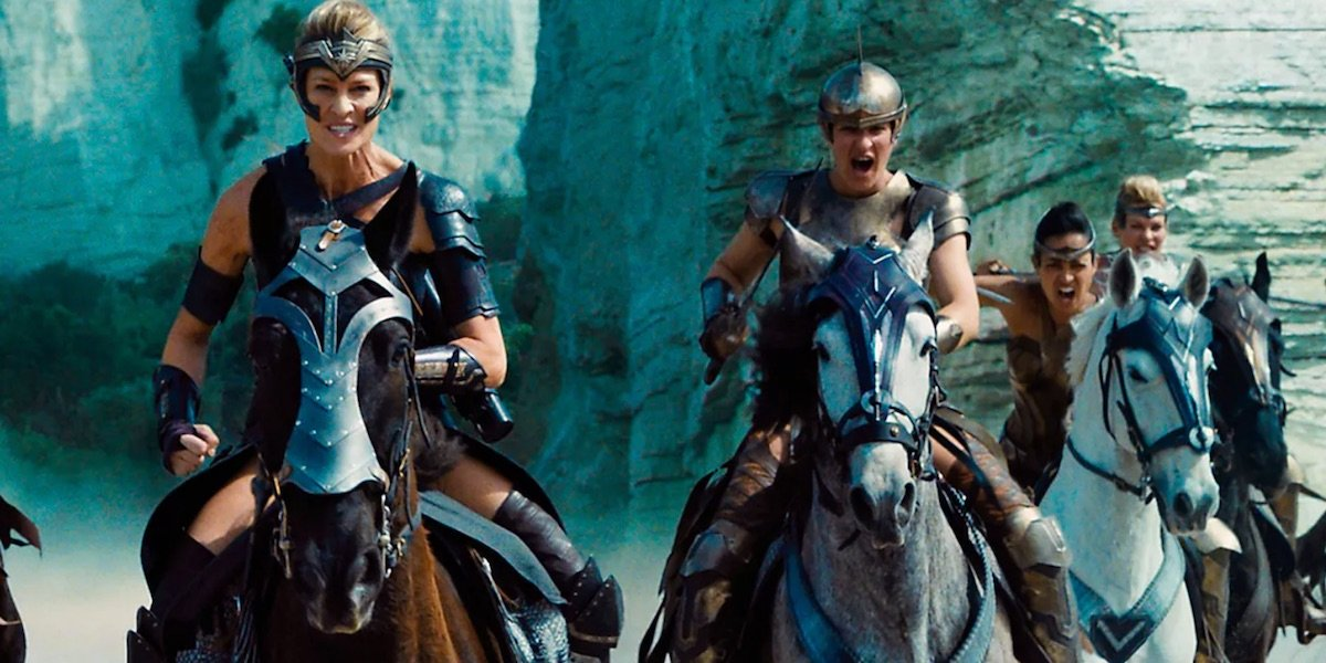 Antiope (Robin Wright) leads a groups of women warriors on horseback.