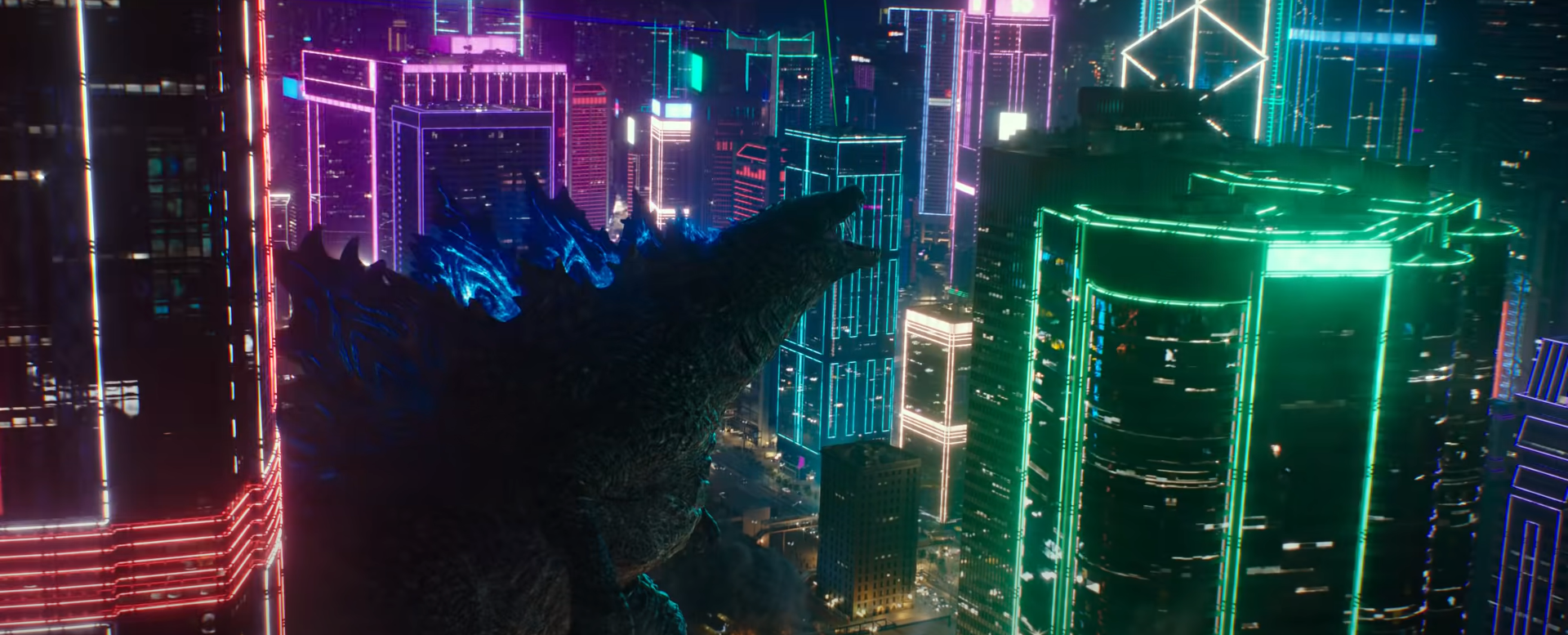 Godzilla walks through Hong Kong's neon-lit buildings and roars