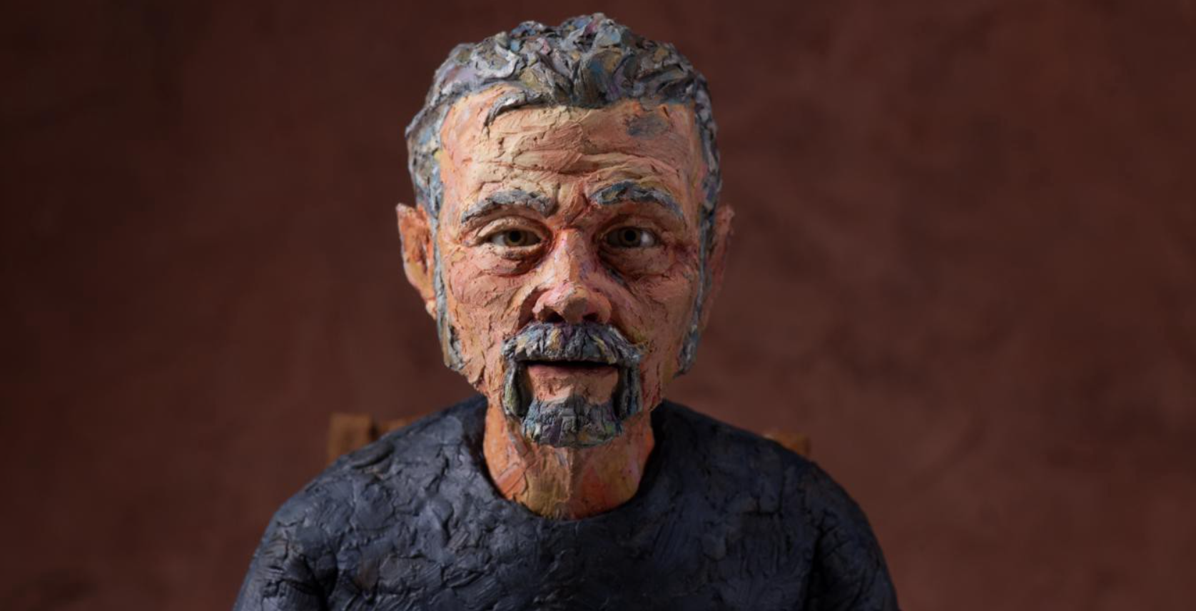 A claymation rendering of an aging white man.