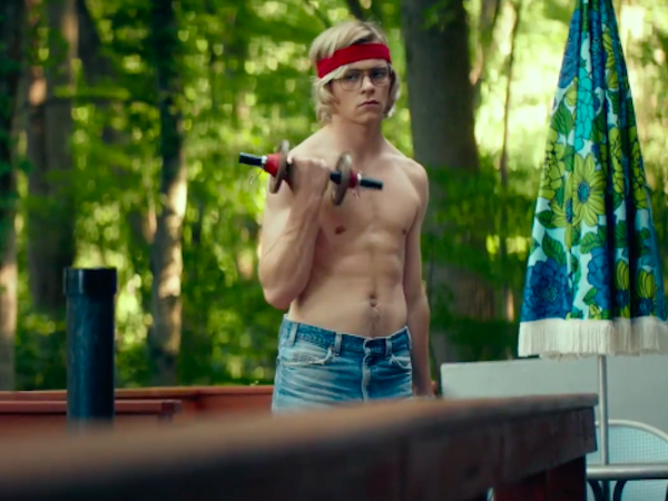 Dahmer lifts dumbells, wearing jeans, a sweatband, and no shirt.