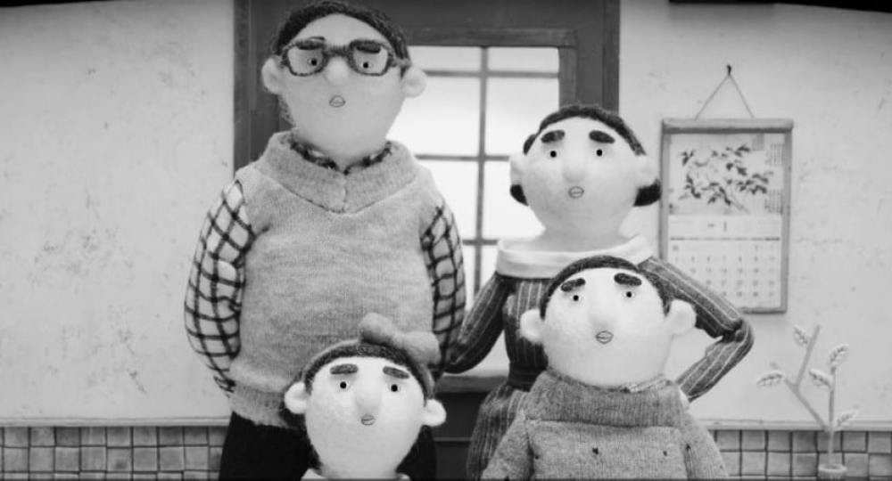 Four plush dolls depicting a Chinese family: A father, a mother, a daughter, and a son.