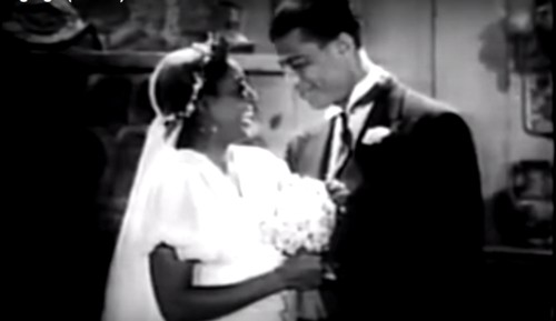 A still from Son of Ingagi. A young Black couple, Eleanor and Bob Lindsay (Daisy Bufford and Alfred Grant) exchange wedding rings.