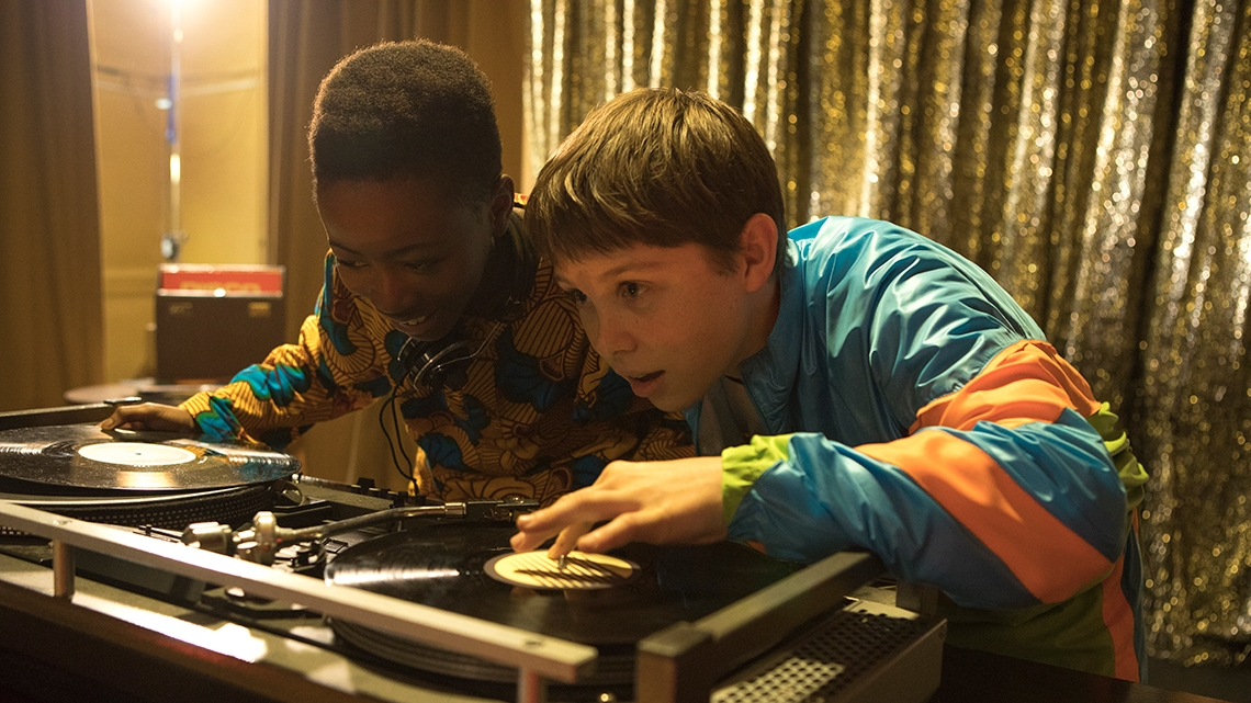 Kobna and Dean act as DJ.