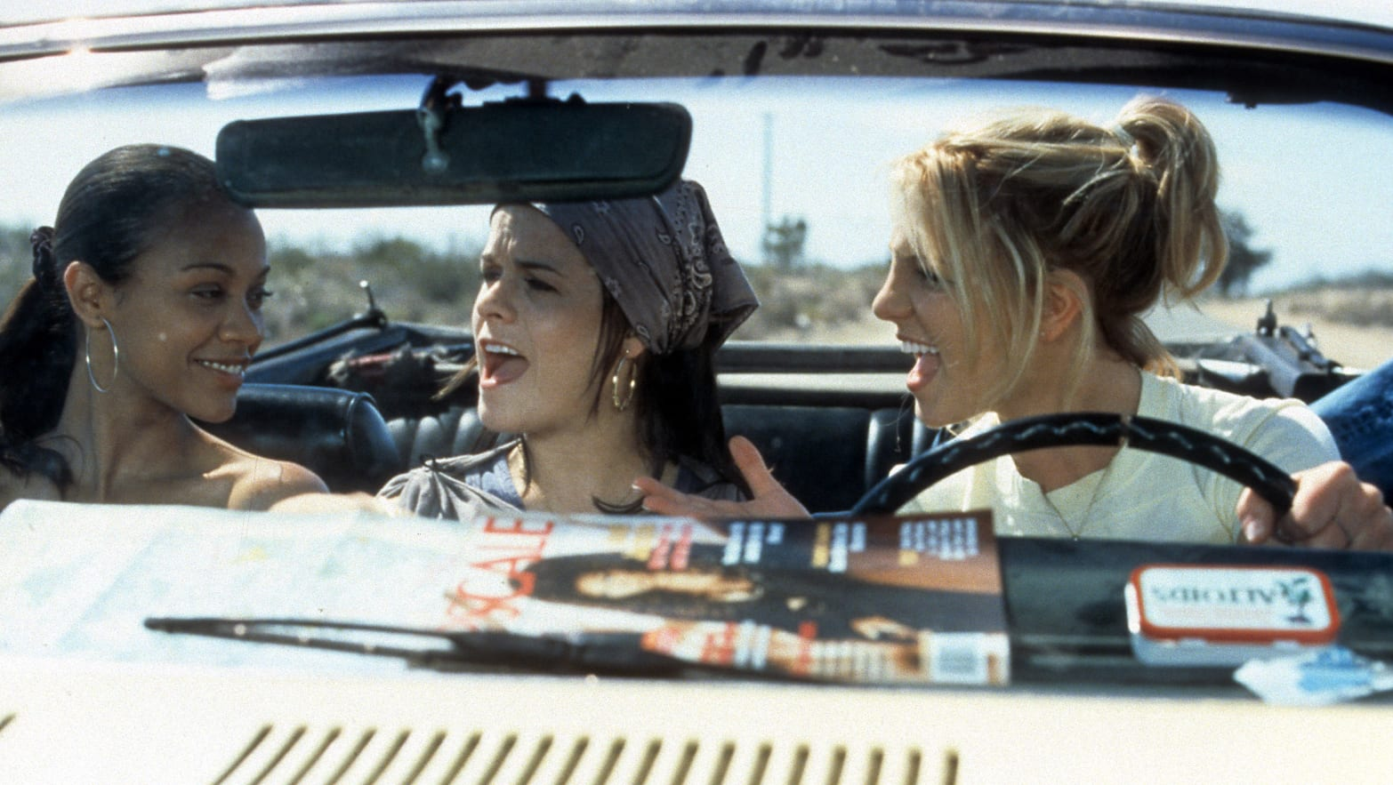 Zoe Saldana, Taryn Manning, and Britney Spears sing together in a car