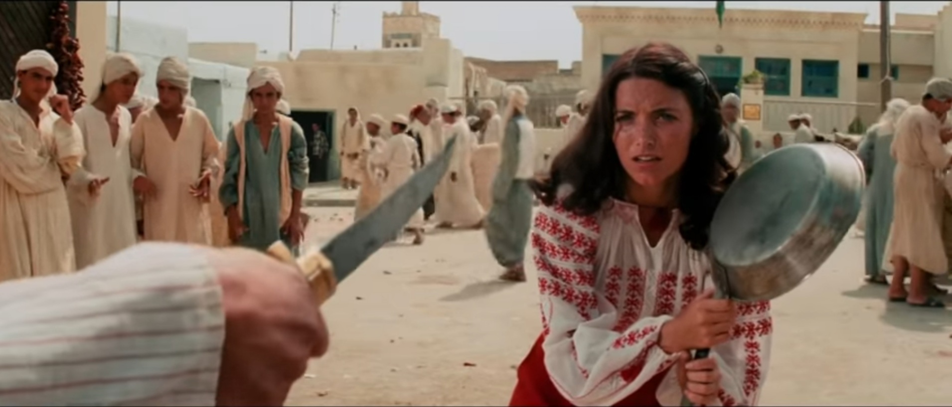 Marion takes on a Nazi-hired Egyptian local with nothing but a frypan.
