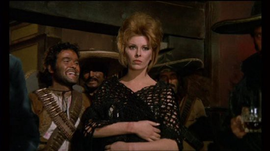 Maria, a young white woman, stands in front of a group of Mexican men wearing sombreros.