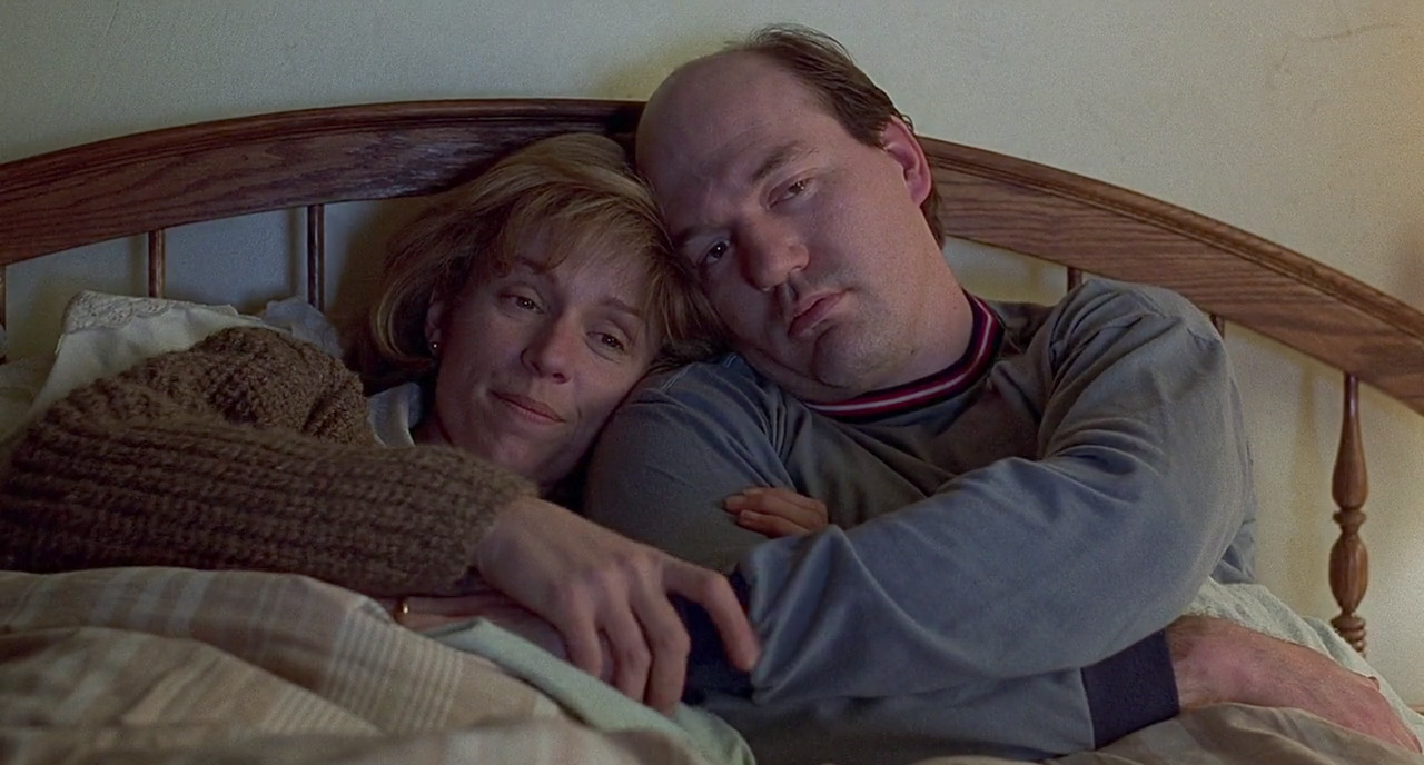 After closing her case, Marge and her husband, Norm (John Carroll Lynch), happily await parenthood.