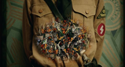 close-up of Jojo's stomach revealing to have butterflies