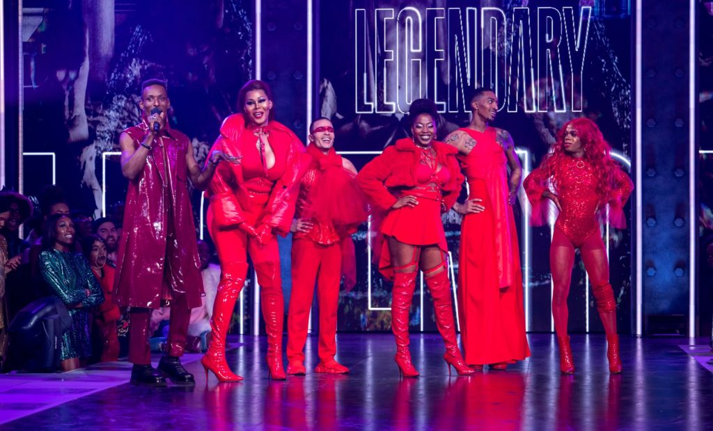 Host Dashuan Wesley presents the members of the House of Lanvain. All wear elaborate red outfits.