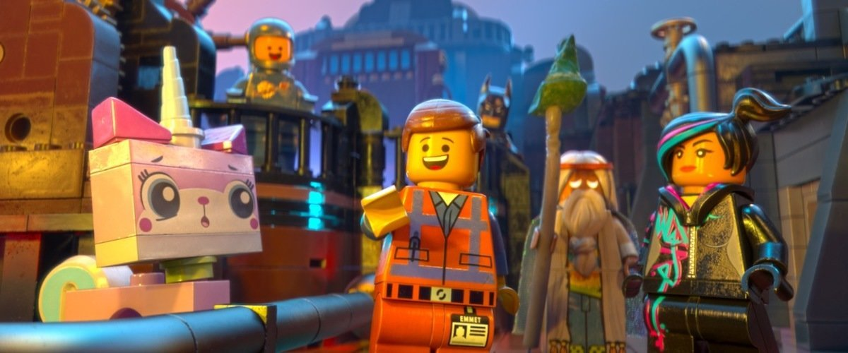 A still from the movie showing Emmet surrounded by his crew of Master Builders