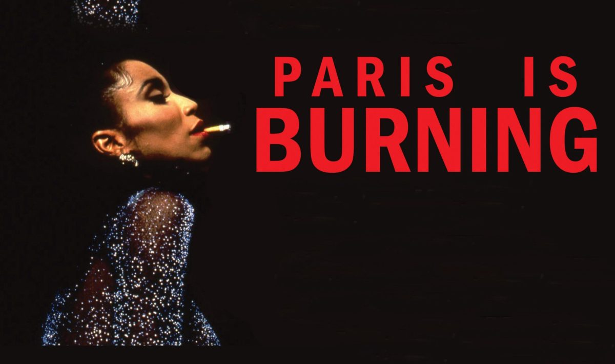 """Octavia St. Laurent, ballroom performer and activist, poses against a black background. She smokes a cigarette and wears a shimmering blue gown. To her right, red text reads """"PARIS IS BURNING"""""""