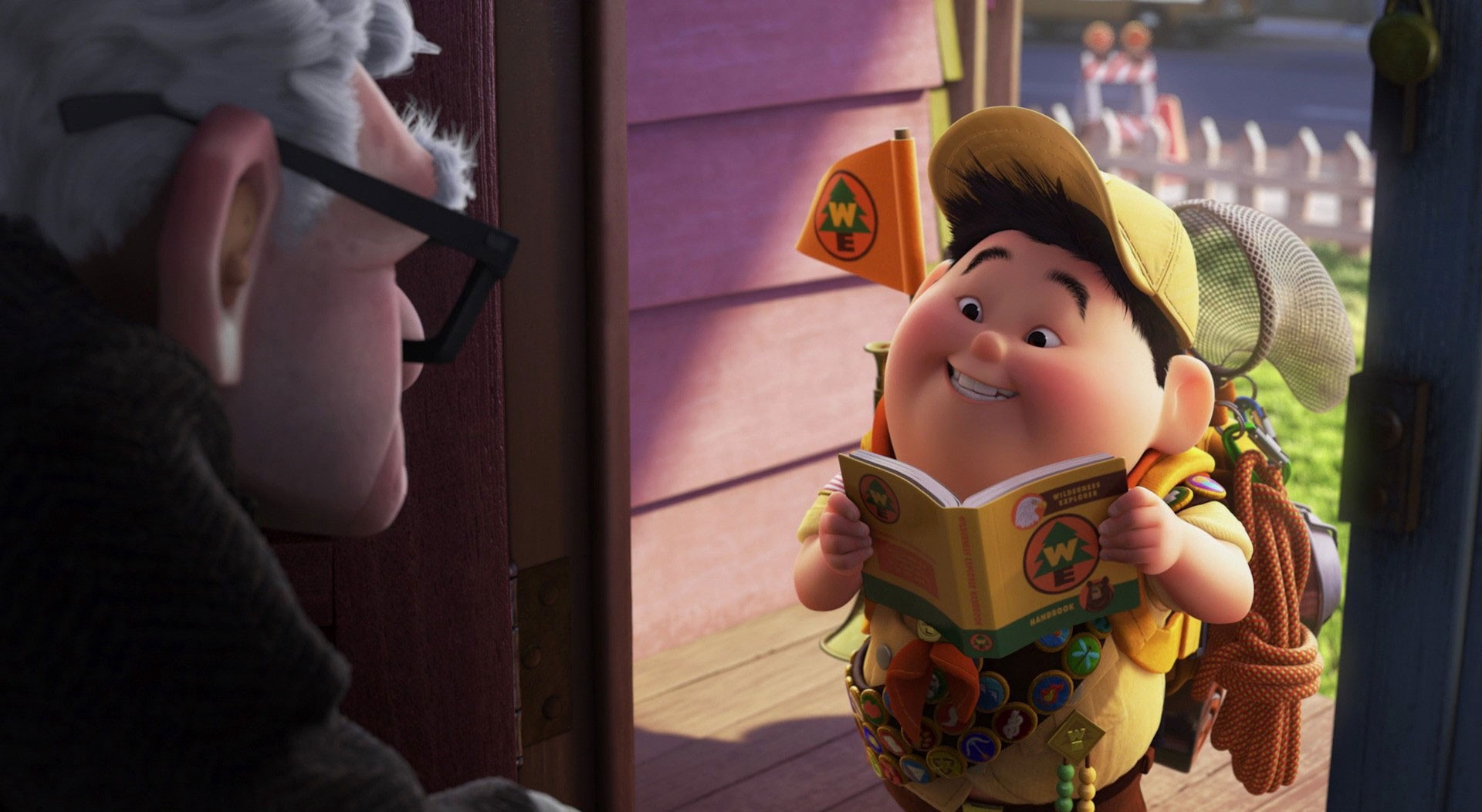 Russell, a young boy, stands in Carl's doorstep. He wears a yellow Boy Scouts-style uniform and reads aloud from a book.