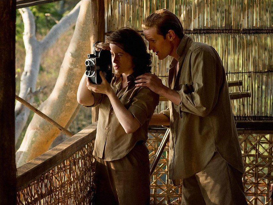 Elizabeth (Claire Foy) and Phillip (Matt Smith) peer into a camera while observing wildlife on a trip to Kenya