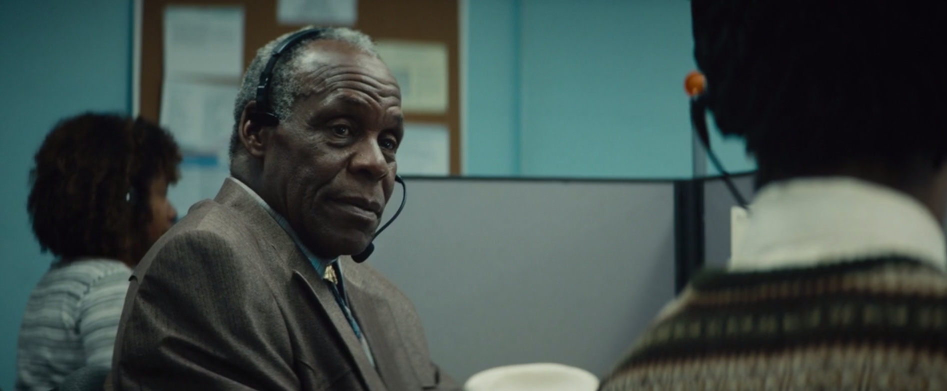 """Langston (Danny Glover) explains to Cash how a """"white voice"""" works."""