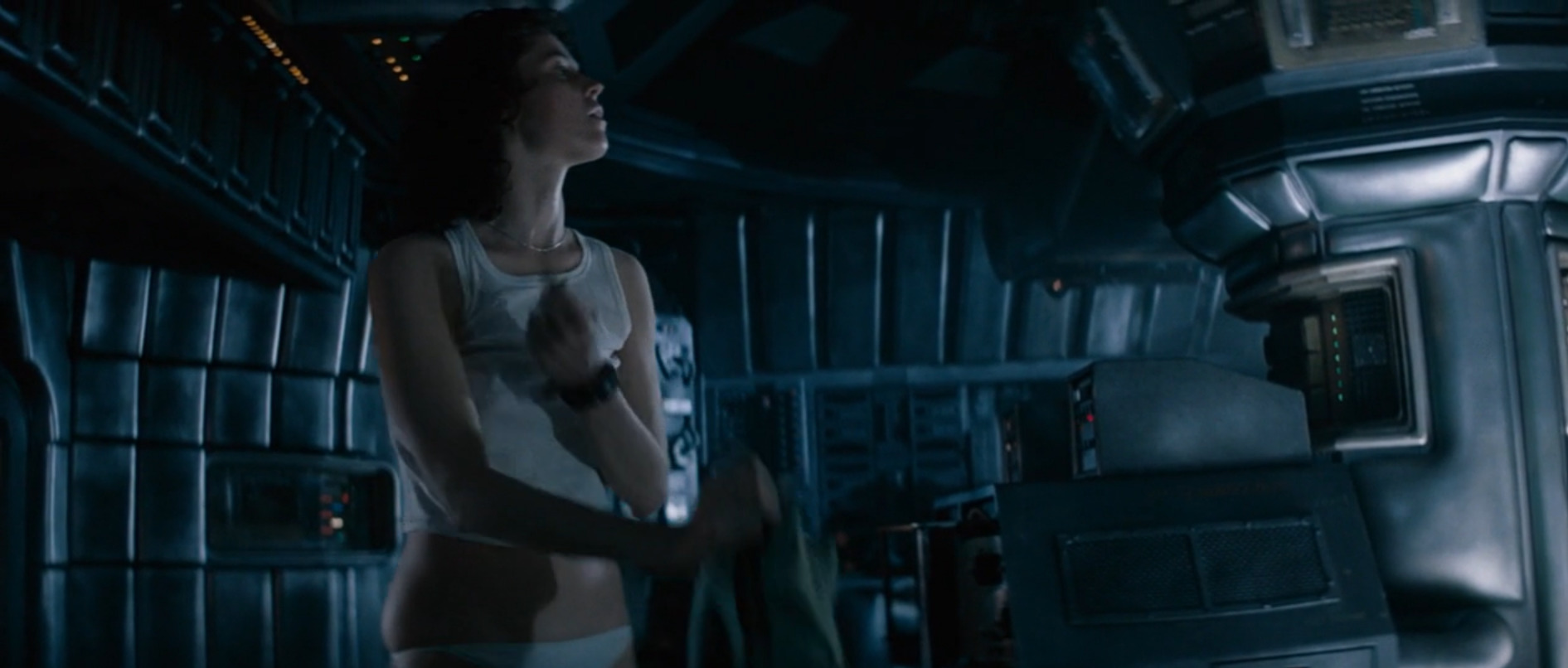 Ripley removes her flight suit after successfully reaching an escape pod, unaware the alien has snuck aboard the pod, as well.