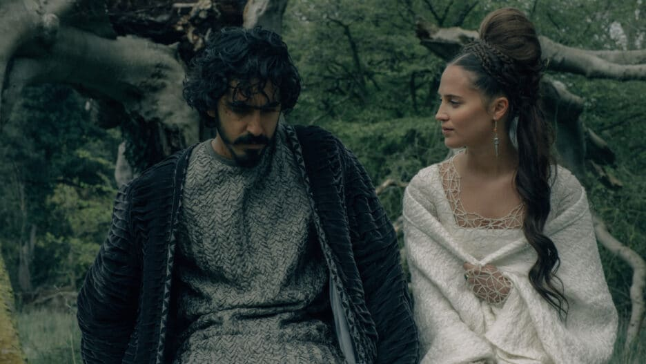 Gawain and Essel are sitting on a tree. She is looking at him, while he is looking away from her.