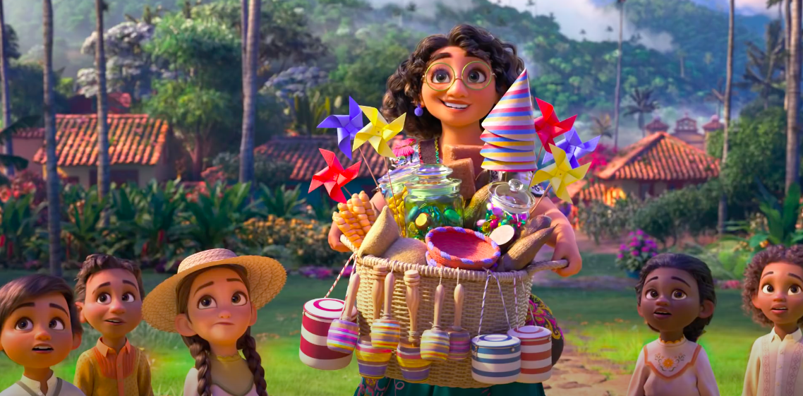 Mirabel holding a basket of trinkets smiling at her family