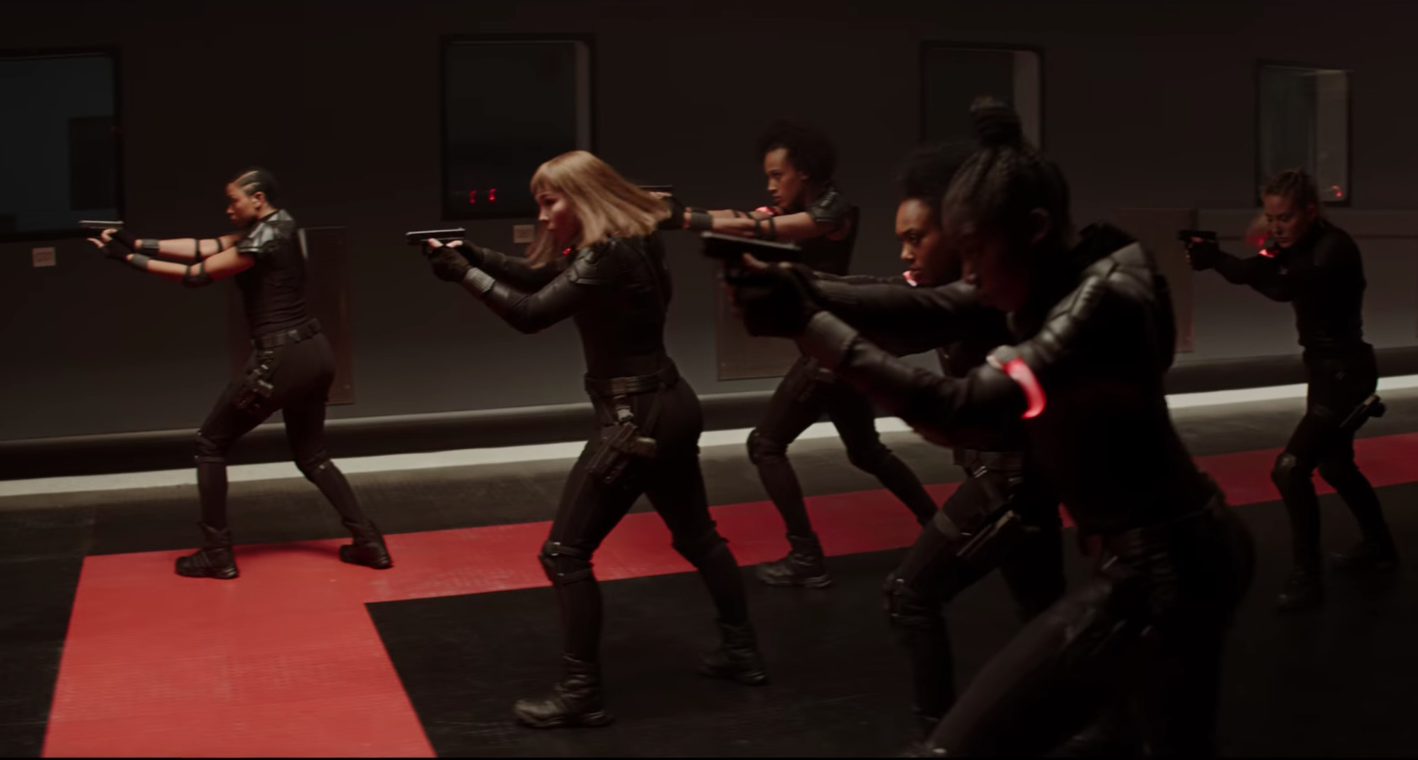 """A still from """"Black Widow"""" of the Red Room where the Black Widows are training"""