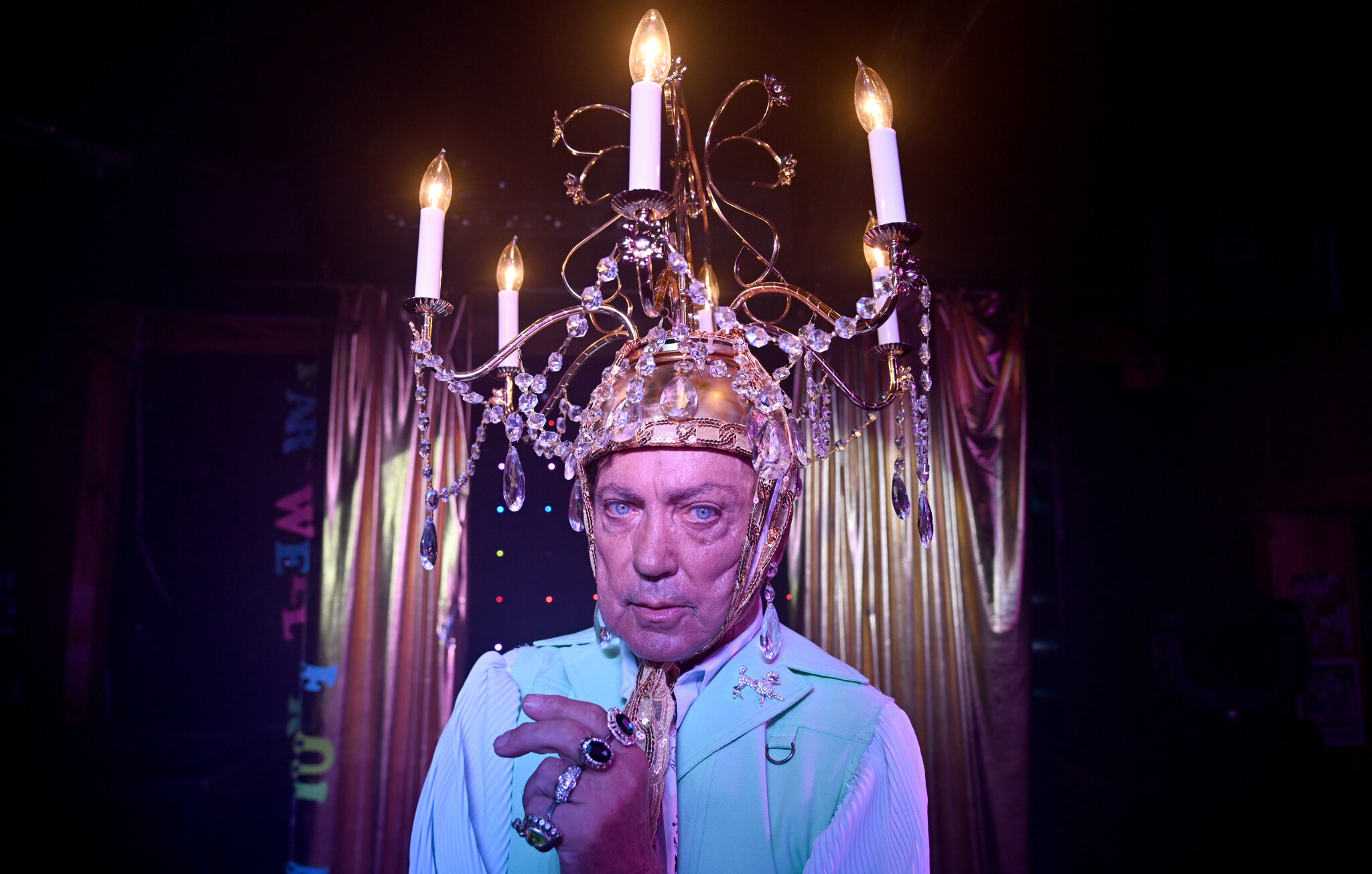 With a candelabra adorned upon his head, Pat performs at a local drag bar for one more shindig before its foreclosure.