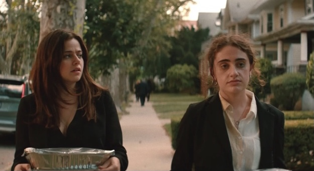 Maya (pictured to the left) helping Danielle (pictured to the right) carry trays of food to an elderly attendant's car. It's within this scene Danielle opens up to Maya on her reasons for being a sugar baby.