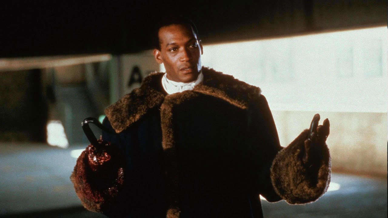 """A still from the 1992 'Candyman"""" of the original Candyman holding his hands out"""