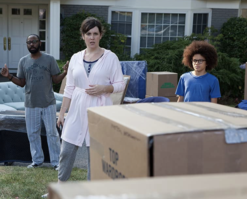 """The Burns family reacting to their """"Little Boxes"""" of possessions being left out on there lawn by movers."""