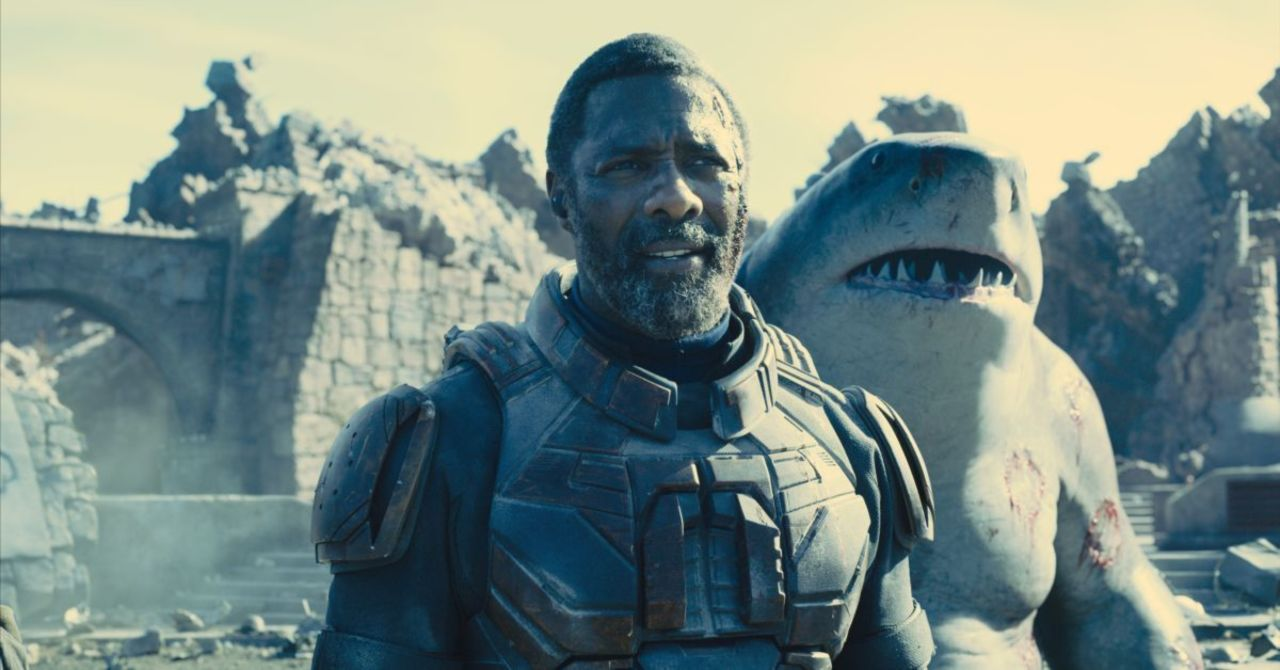 """A still from """"The Suicide Squad"""" of Bloodsport with King Shark in the background"""
