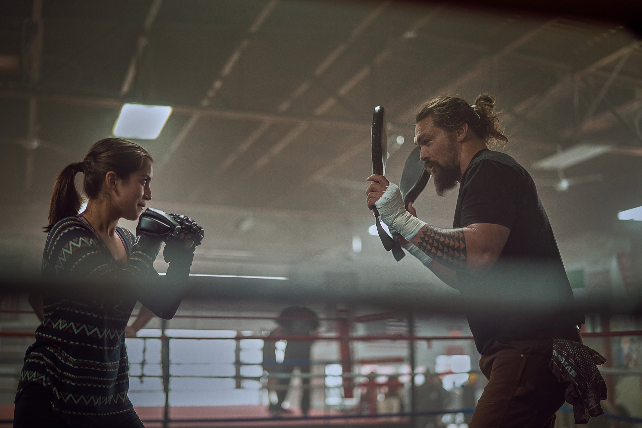 """A still from """"Sweet Girl"""" of Rachel and Ray training in the boxing ring"""