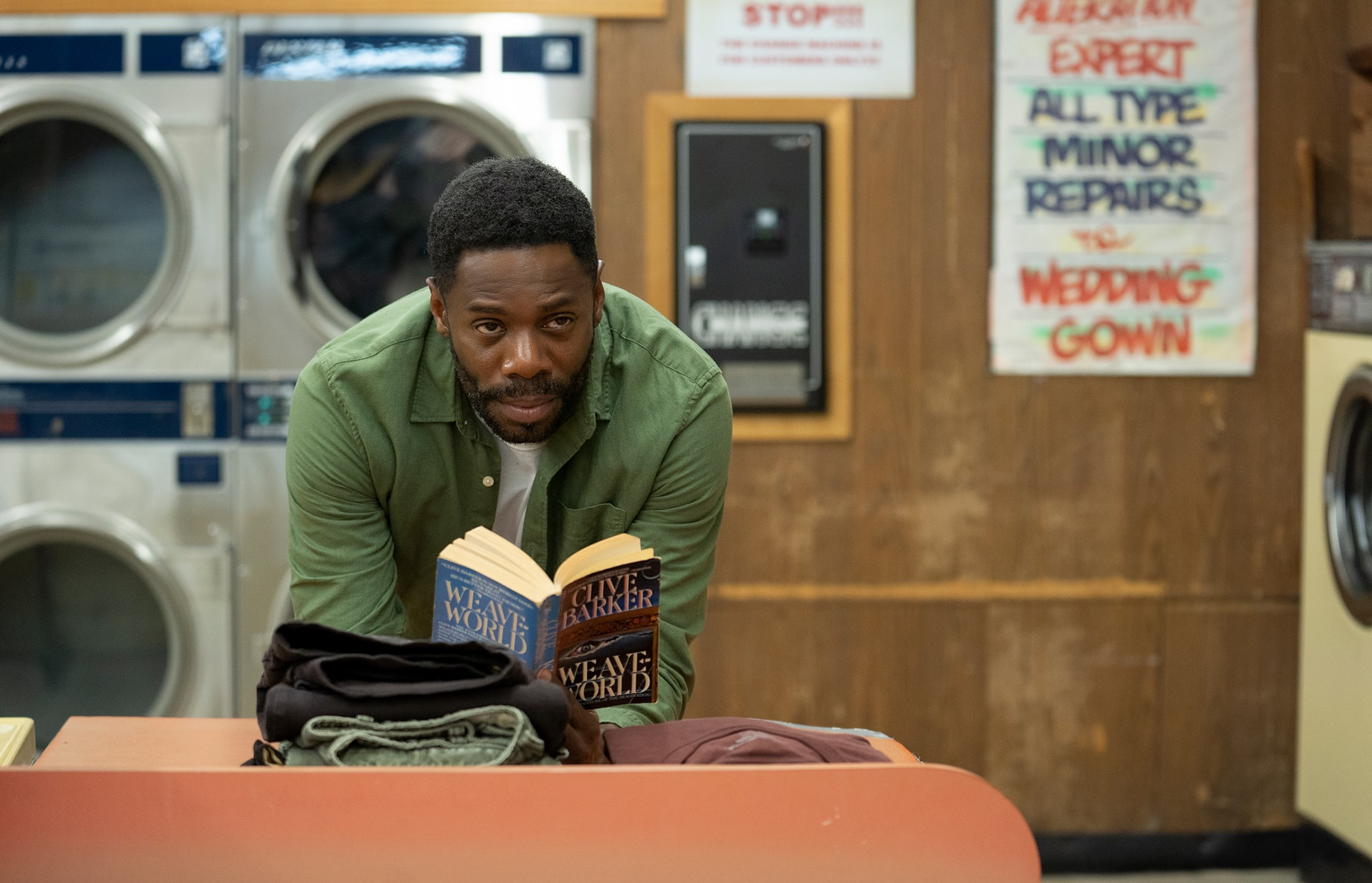 A still from 'Candyman' of Burke reading in the laundromat