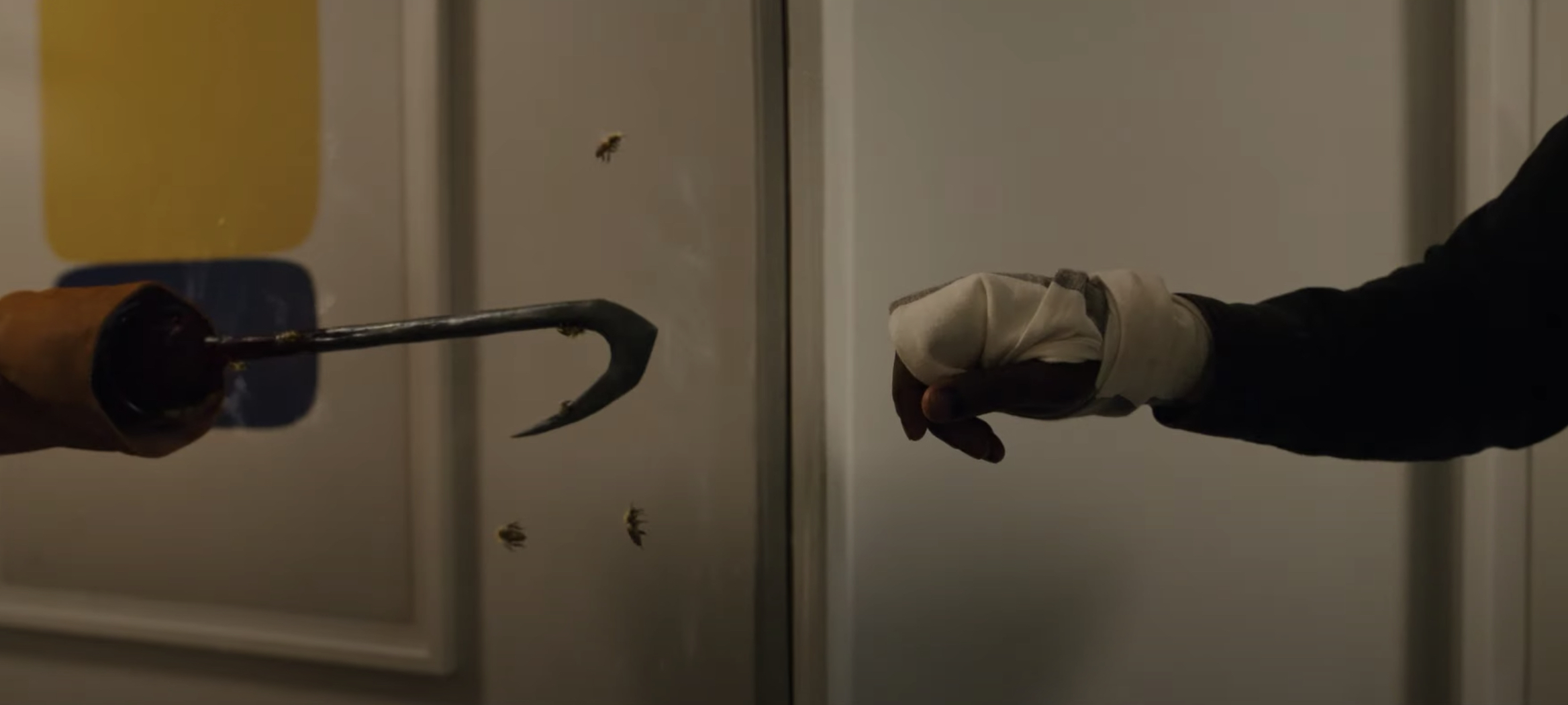 A still from 'Candyman' of Anthony reaching for his reflection of Candyman's hook