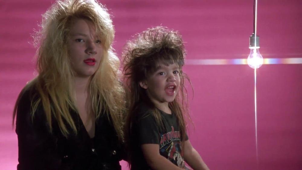 A mom and her young daughter in a pink backdrop with a light bulb