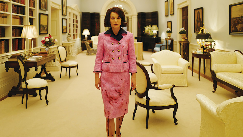 Jackie Kennedy inside the white house, covered in blood from the bottom down