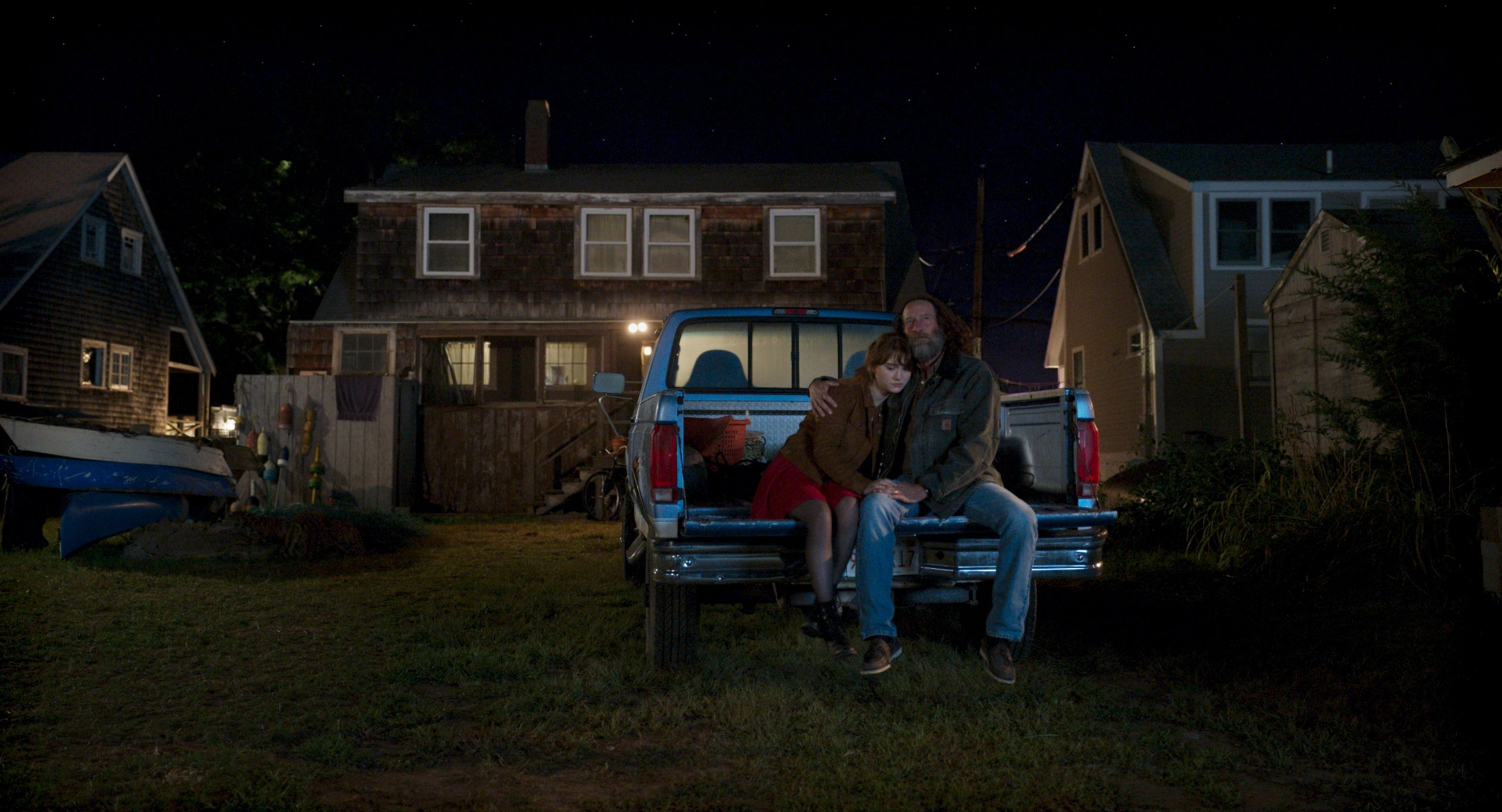 """A still from """"CODA"""" of Frank and Ruby sitting on his truck outside"""